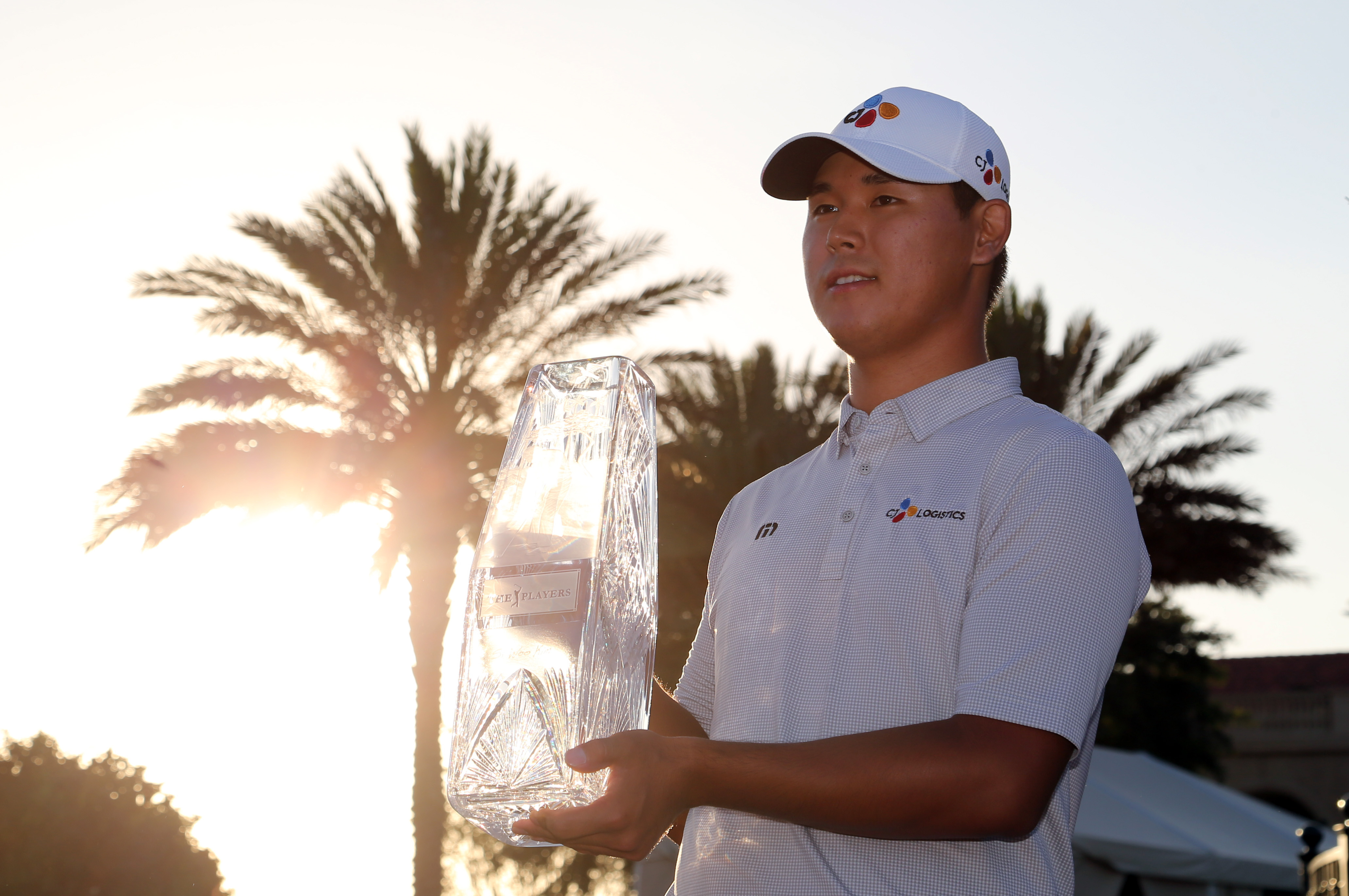 May 14, 2017; Ponte Vedra Beach, FL, USA; Si Woo Kim hoist the trophy after winning The Players Championship golf tournament at TPC Sawgrass – Stadium ...