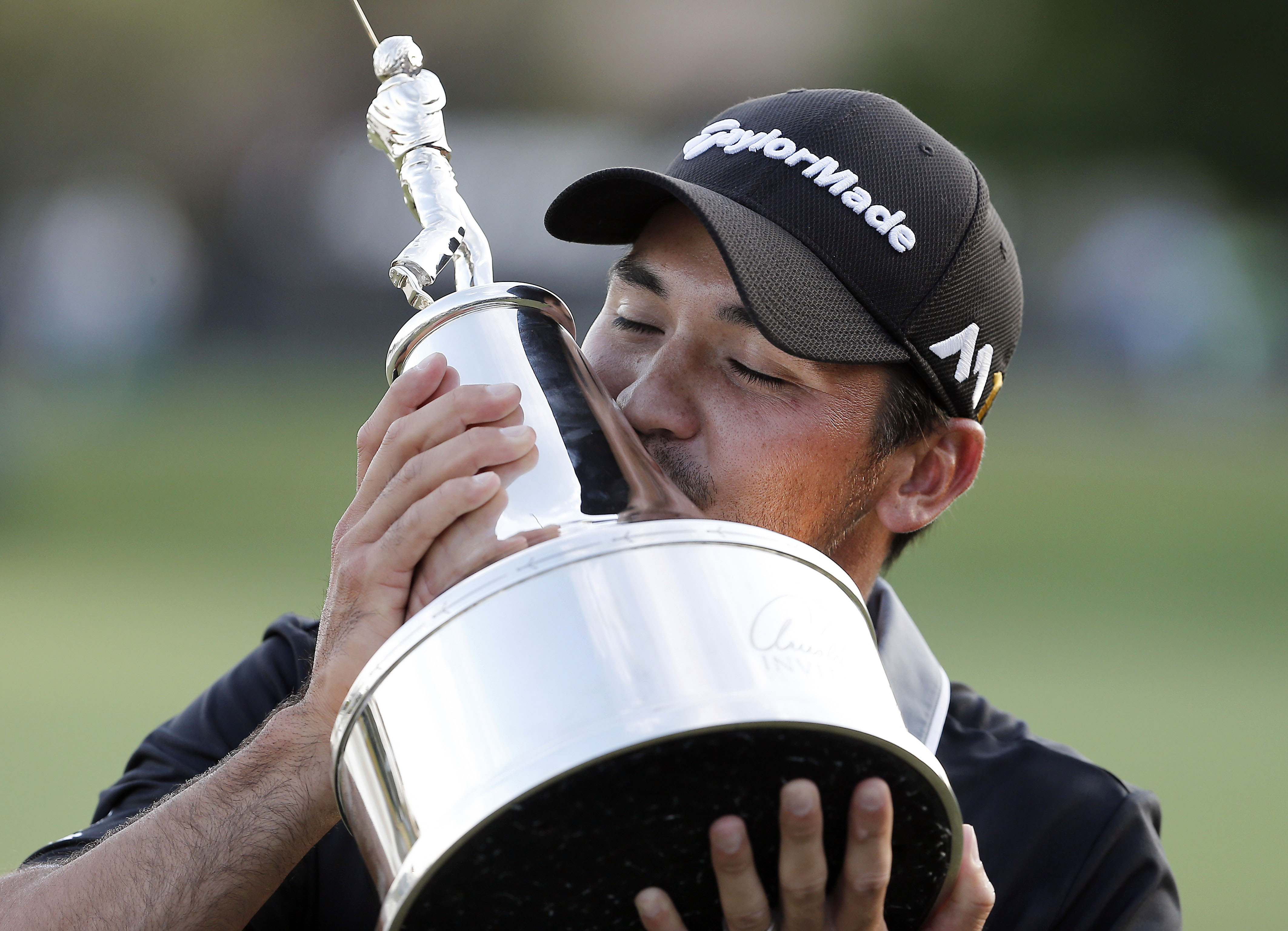 Mar 20, 2016; Orlando, FL, USA; Jason Day of Australia celebrates with the Champions trophy following his win of the Arnold Palmer Invitational presented by ...